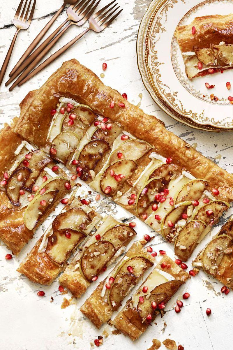 """<p>Who said you can't have something sweet before dinner? This apple tart from Lauren Conrad's kitchen is drizzled in honey and garnished with almonds and pomegranate seeds for an elegant start to the evening.</p><p><em>Get the recipe from <a href=""""https://www.goodhousekeeping.com/food-recipes/a41395/best-brie-apple-tart/"""" rel=""""nofollow noopener"""" target=""""_blank"""" data-ylk=""""slk:Good Housekeeping"""" class=""""link rapid-noclick-resp"""">Good Housekeeping</a>.</em><br></p>"""