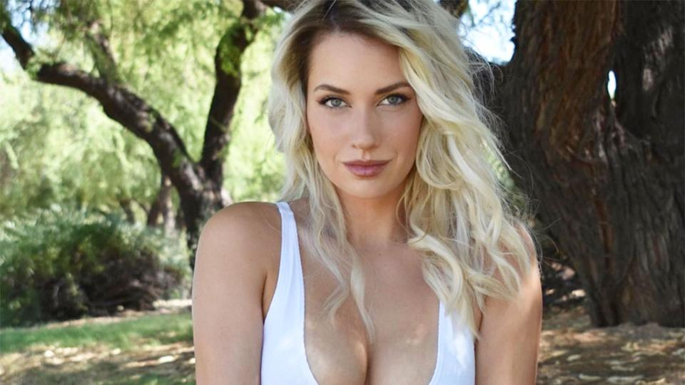 Paige Spiranac is seen here posing for a photo at a golf course in the USA.
