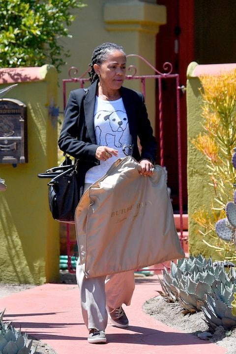 Meghan Markle's mother Doria Ragland seen departing Los Angeles to head to her daughter's wedding - Credit: MEGA