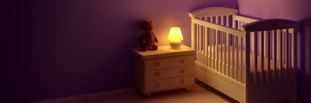 a baby's room with a crib and a night light