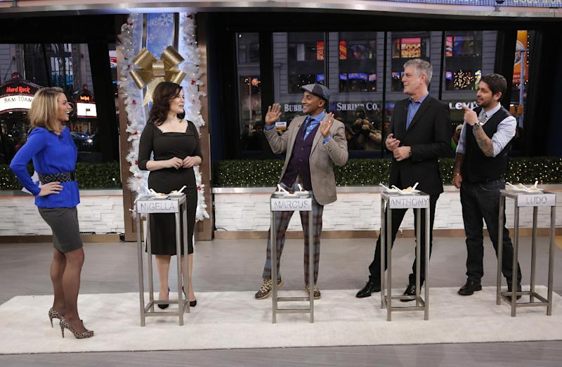 """In this photo provided by ABC, Amy Robach, left, hosts the cast of """"The Taste,"""" from left, Nigella Lawson, Marcus Samuelsson, Anthony Bourdain, and Ludo Lefebvre, on """"Good Morning America,"""" at the ABC studio Thursday, Jan. 2, 2014, in New York. Lawson testified last month at the fraud trial of two former aides, who were ultimately acquitted of funding a luxury lifestyle with credit cards loaned to them by Lawson and her ex-husband Charles Saatchi. (AP Photo/ABC, Heidi Gutman)"""
