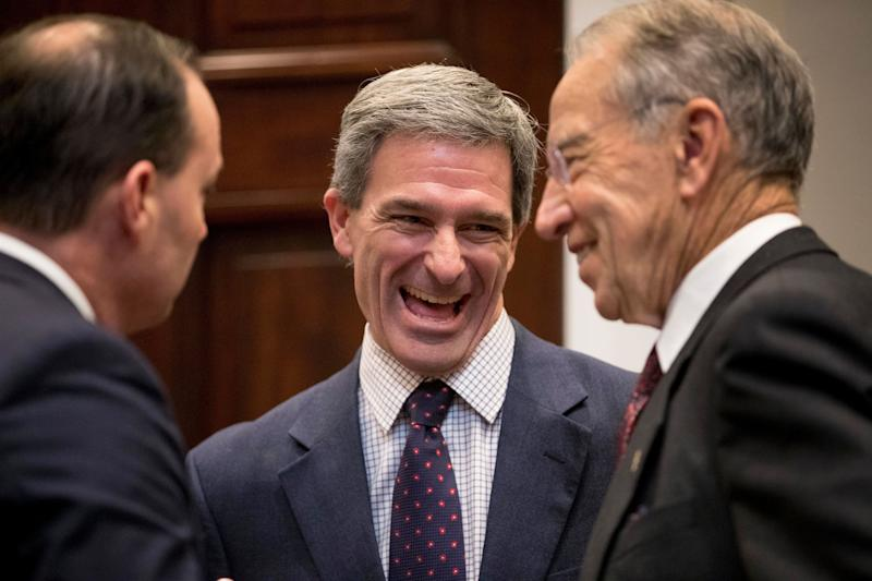 Former Virginia Attorney General Ken Cuccinelli, middle, is expected to join the Department of Homeland Security to play a lead role on immigration.  (Photo: ASSOCIATED PRESS)