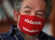 Andras Arato, Klubradio's director and CEO is seen in his office in Budapest, Tuesday, Feb. 9, 2021. One of Hungary's last remaining independent radio stations will be forced off the airwaves and limited to online broadcasts after a court upheld a decision by media regulators not to extend its broadcasting license. The court dismissed a challenge brought by Klubradio, a liberal-leaning commercial station broadcasting in Budapest. (AP Photo/Laszlo Balogh)