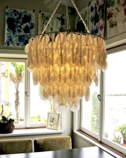 """<div class=""""caption-credit""""> Photo by: Design Sponge</div><b>Paper capiz shell chandelier</b> <br> Breathtaking, right? Semi-transparent Capiz shells with their pearlescent finish are known for their lavish design features. Now you can get the expensive look of Capiz shell for a fraction of the cost with wax paper. Yes, wax paper! Create your very own faux Capiz chandelier to make a dramatic design statement that only looks like it cost a fortune! <br> <i>Get the full tutorial at <a href=""""http://www.designsponge.com/2010/08/diy-project-brennas-paper-capiz-shell-chandelier.html"""" rel=""""nofollow noopener"""" target=""""_blank"""" data-ylk=""""slk:Design Sponge"""" class=""""link rapid-noclick-resp"""">Design Sponge</a></i>"""