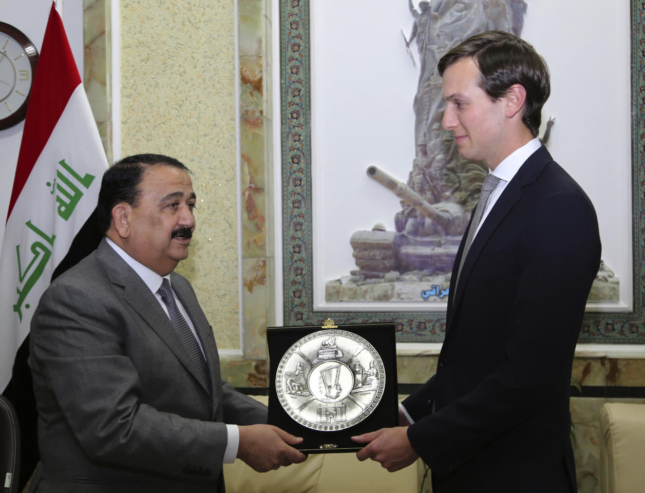 FILE - In this April 3, 2017, file photo, Jared Kushner, right, U.S. President Donald Trump's son-in-law and senior adviser, receives a gift from Iraqi Defense Minister, Ifran al-Hayali, at the Ministry of Defense, Baghdad, Iraq. Not since John F. Kennedy appointed his brother Bobby to be attorney general and his brother-in-law as director of the Peace Corps has a president leaned so heavily on his family. Kushner is a senior adviser to the president with a bulging and growing portfolio that includes everything from brokering Mideast peace to restructuring the federal government. (AP Photo)