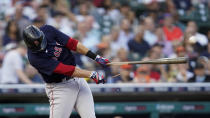 Boston Red Sox's J.D. Martinez hits a broken bat single against the Detroit Tigers in the third inning of a baseball game in Detroit, Tuesday, Aug. 3, 2021. (AP Photo/Paul Sancya)