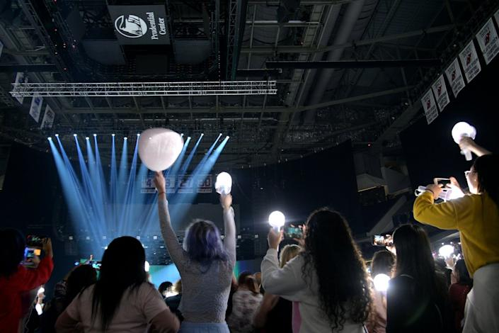 "<span class=""caption"">K-pop fans in the U.S. have been urging industry professionals to speak out.</span> <span class=""attribution""><a class=""link rapid-noclick-resp"" href=""https://www.gettyimages.com/detail/news-photo/fans-watch-seventeen-perform-in-concert-during-their-ode-to-news-photo/1198765399?adppopup=true"" rel=""nofollow noopener"" target=""_blank"" data-ylk=""slk:Michael Loccisano/Getty Images"">Michael Loccisano/Getty Images</a></span>"