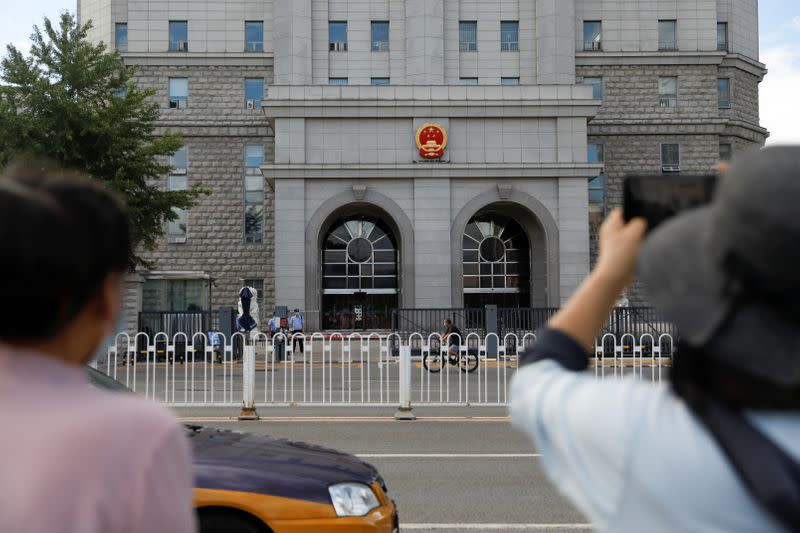 China sentences Xi critic to 18 years for graft