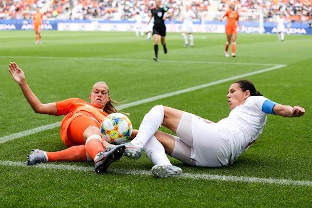 #12 Christine Sinclair of Canada competes for the ball with #8 Sherida Spitse of Netherlands during the 2019 FIFA Women's World Cup France group E match between Netherlands and Canada at Stade Auguste Delaune on June 20, 2019 in Reims, France. (Photo by Zhizhao Wu/Getty Images)