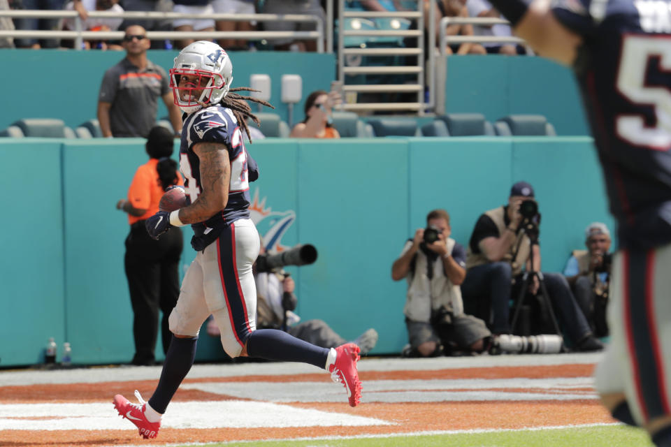 New England Patriots cornerback Stephon Gilmore (24) looks back after scoring a touchdown, during the second half at an NFL football game against the Miami Dolphins, Sunday, Sept. 15, 2019, in Miami Gardens, Fla. (AP Photo/Lynne Sladky)