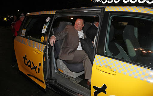 Gerard Gallant, former Florida Panthers head coach, gets into a cab after being relieved of his duties following an NHL hockey game against the Carolina Hurricanes, Sunday, Nov. 27, 2016, in Raleigh, N.C. (AP Photo/Karl B DeBlaker)