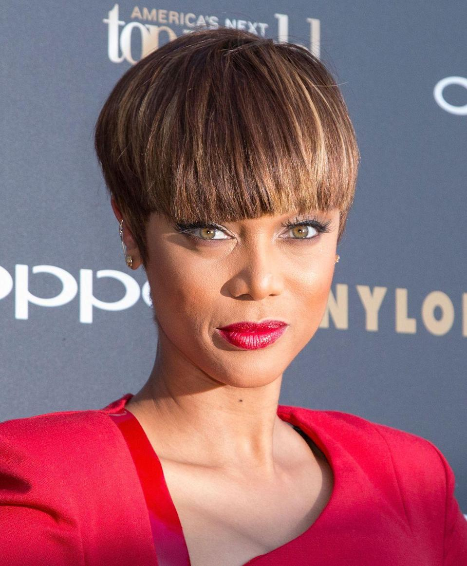 <p>If you're a little self-conscious about a high forehead, ask your stylist for long bangs that start high to disguise it. Or go bold like Tyra Banks and make your hair all one length.</p>