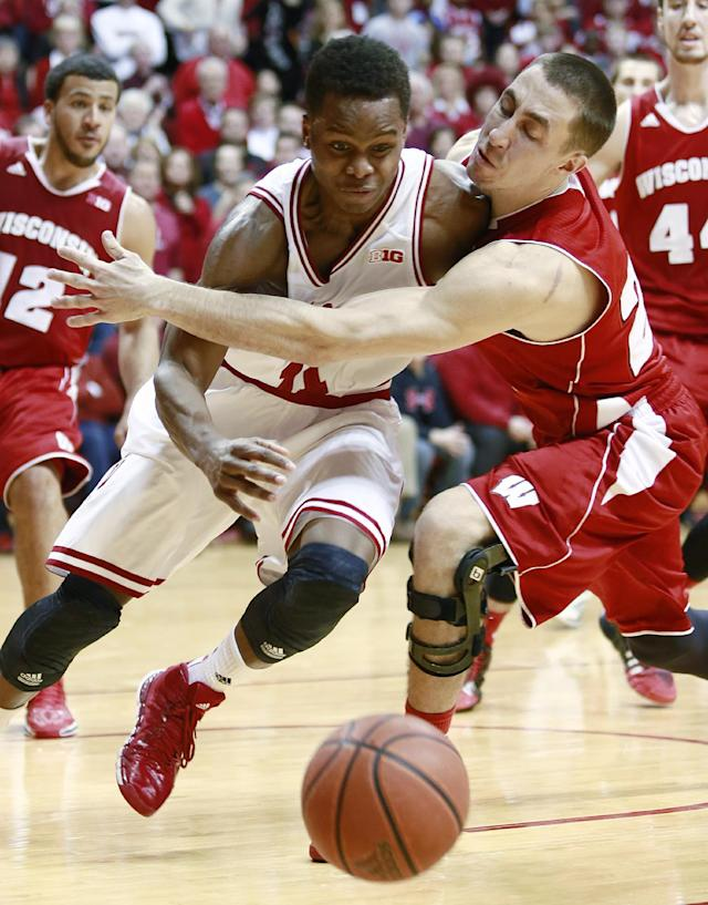 "Wisconsin guard Josh Gasser, right, fouls Indiana guard Kevin ""Yogi"" Ferrell, left, in the second half of an NCAA basketball game in Bloomington, Ind., Tuesday, Jan. 14, 2014. Indiana won 75-72. (AP Photo/R Brent Smith)"