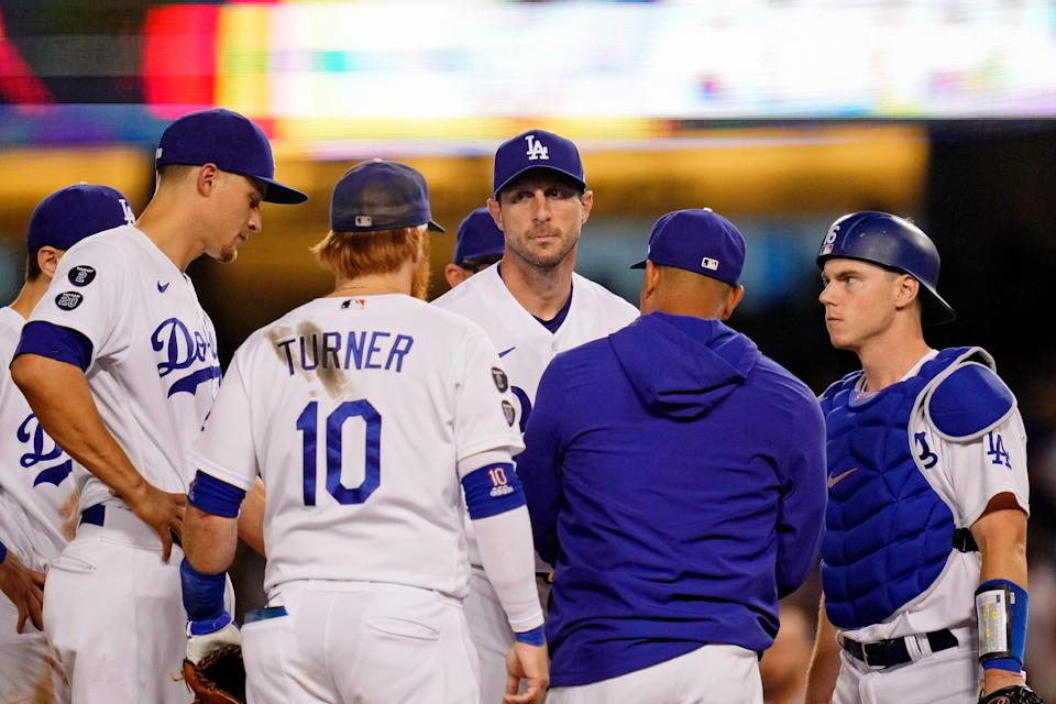 NL wild card: Dodgers starting pitcher Max Scherzer reacts as manager Dave Roberts pulls him out of the game.