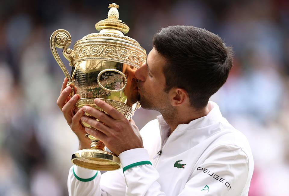 LONDON, ENGLAND - JULY 11:  Novak Djokovic of Serbia celebrates with the trophy after winning his men's Singles Final match against Matteo Berrettini of Italy on Day Thirteen of The Championships - Wimbledon 2021 at All England Lawn Tennis and Croquet Club on July 11, 2021 in London, England. (Photo by Julian Finney/Getty Images)