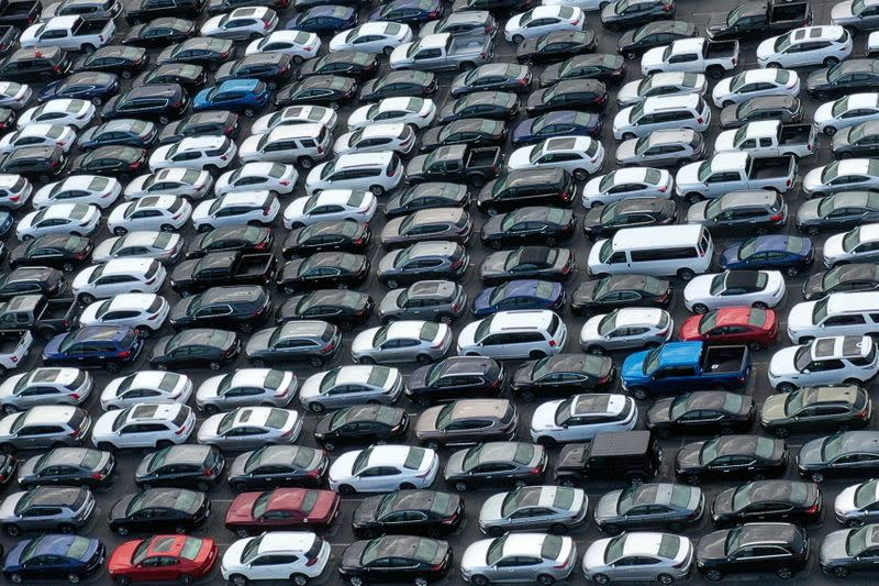 FILE PHOTO: Unused rental cars fill the Dodger Stadium parking lot as the spread of the coronavirus disease (COVID-19) continues, in Los Angeles
