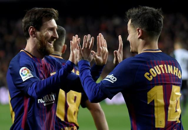 Barcelona's Philippe Coutinho (R) celebrates after scoring a goal with Lionel Messi during their Spanish Copa del Rey (King's Cup) second leg semi-final match against Valencia, at the Mestalla stadium in Valencia, on February 8, 2018