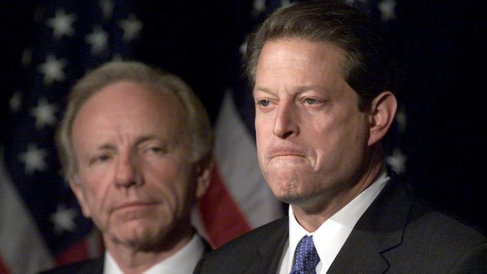 Vice President Al Gore with Sen. Joseph Lieberman by his side makes a statement to reporters, November 8, 2000