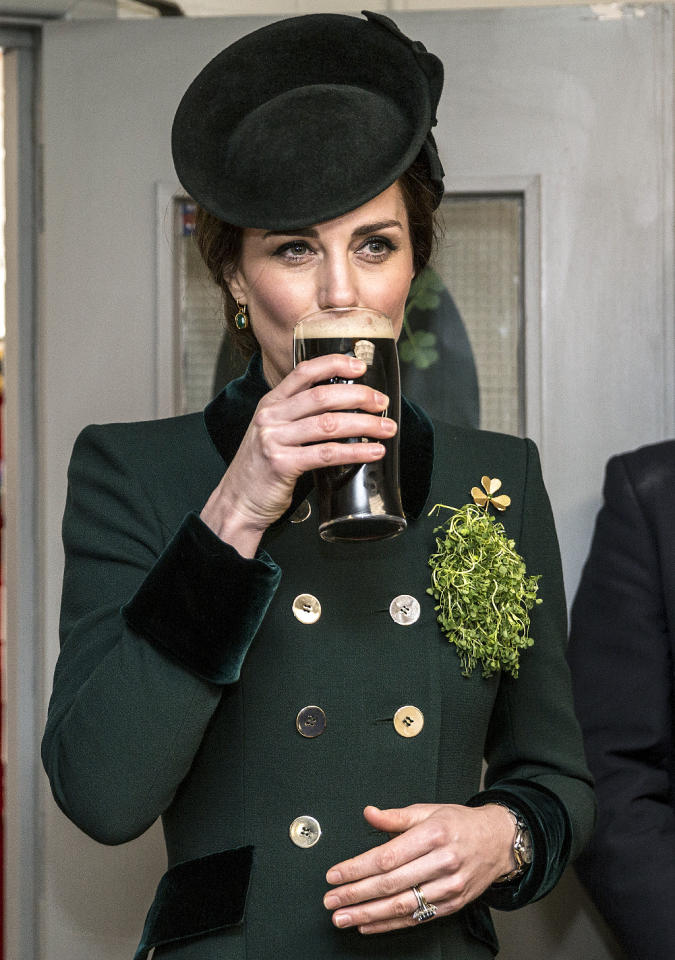 <p>The Duchess of Cambridge sipped on Guinness while watching London's annual St. Patrick's Day parade. Kate would have needed a leprechaun by her side to look any more appropriate for the occasion! (Photo: Richard Pohle – WPA Pool/Getty Images) </p>