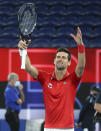 Serbia's Novak Djokovic celebrates after defeating Germany's Alexander Zverev in their ATP Cup match in Melbourne, Australia, Friday, Feb. 5, 2021.(AP Photo/Hamish Blair)
