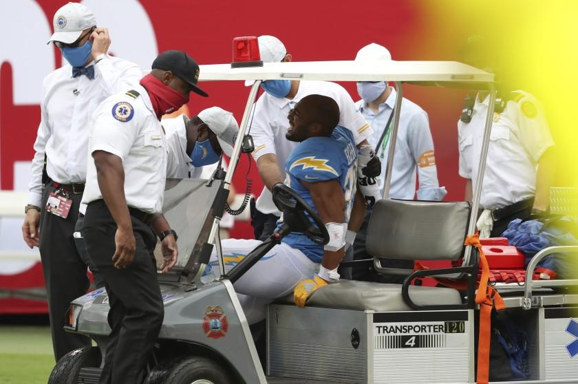 Los Angeles Chargers running back Austin Ekeler (30) is carted off the field after getting hurt.