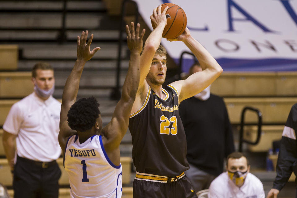 Valparaiso's Ben Krikke (23) looks to pass around Drake's JosephYesufu (1) during the second half of an NCAA college basketball game on Sunday, Feb. 7, 2021, in Valparaiso, Ind. (AP Photo/Robert Franklin)