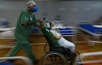 A Covid-19 patient is treated in a hospital set up at a sports gym, in Santo Andre, Sao Paulo state, Brazil in March 2021