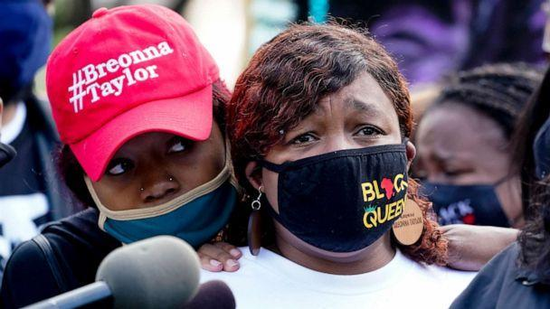 PHOTO: Tamika Palmer, the mother of Breonna Taylor, right, listens to a news conference, Sept. 25, 2020, in Louisville, Ky. (Darron Cummings/AP)