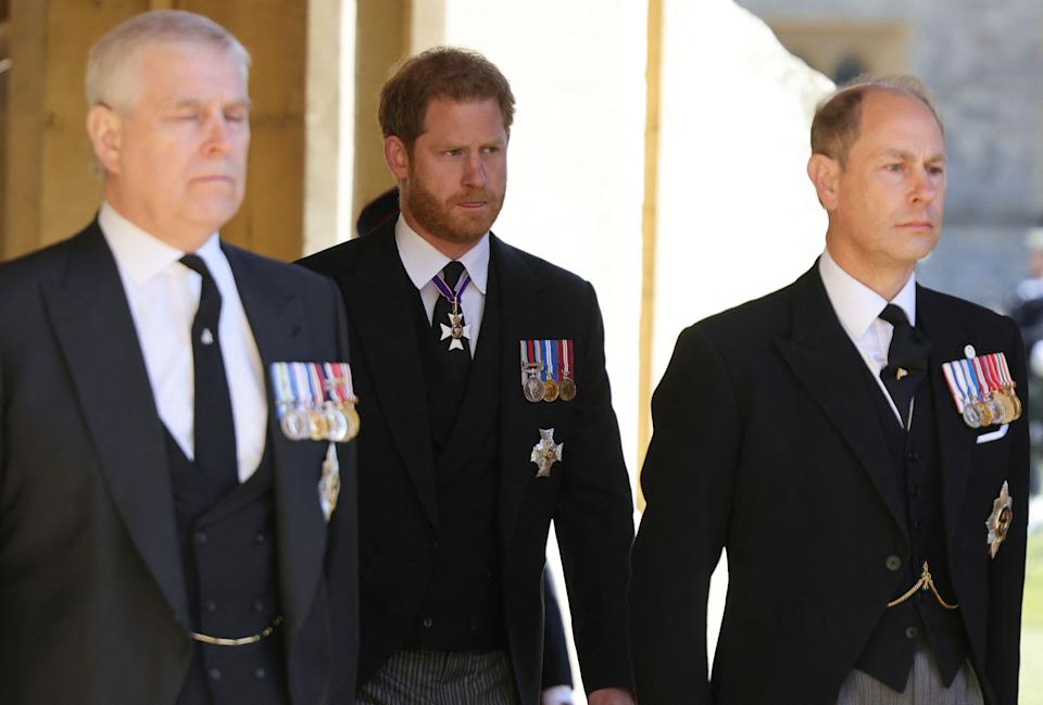 Britain's Prince Harry, Duke of Sussex, (C) attends with Britain's Prince Andrew, Duke of York, (L) and Britain's Prince Edward, Earl of Wessex, the ceremonial funeral procession of Britain's Prince Philip, Duke of Edinburgh to St George's Chapel in Windsor Castle in Windsor, west of London, on April 17, 2021. - Philip, who was married to Queen Elizabeth II for 73 years, died on April 9 aged 99 just weeks after a month-long stay in hospital for treatment to a heart condition and an infection. (Photo by CHRIS JACKSON / various sources / AFP) (Photo by CHRIS JACKSON/AFP via Getty Images)