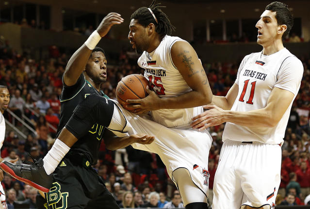 Texas Tech's Aaron Ross (15) grabs away a rebound from Baylor's Royce O'Neale as teammate Dejan Kravic(11) looks on during an NCAA college basketball game in Lubbock, Texas, Wednesday, Jan, 15, 2014. (AP Photo/Lubbock Avalanche-Journal, Tori Eichberger)