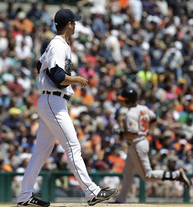 Detroit Tigers pitcher Rick Porcello walks back to the mound as Baltimore Orioles' Taylor Teagarden rounds third base after hitting a three-run home in the fourth inning of a baseball game in Detroit, Wednesday, June 19, 2013. (AP Photo/Paul Sancya)