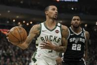 Milwaukee Bucks' George Hill drives past San Antonio Spurs' Rudy Gay during the first half of an NBA basketball game Saturday, Jan. 4, 2020, in Milwaukee. (AP Photo/Morry Gash)