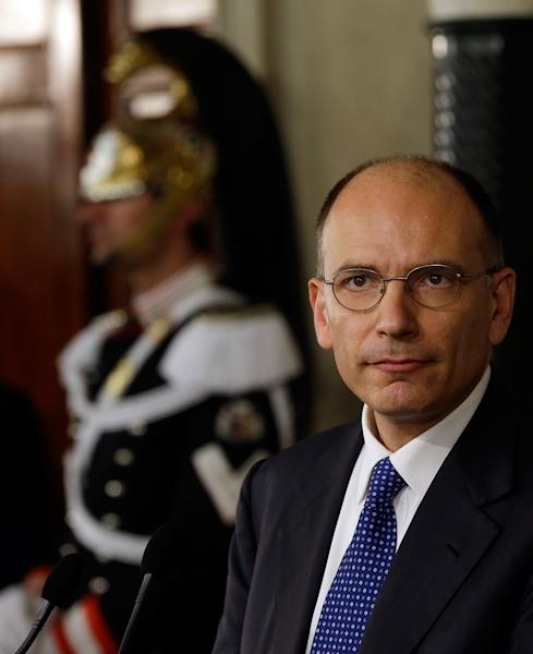 """Italian Democratic Party lawmaker Enrico Letta makes his statement to the media after talks with Italian President Giorgio Napolitano, in Rome's Quirinale presidential palace, Wednesday, April 24, 2013. Italy's president has appointed Enrico Letta as premier, asking him to try to form a government to end Italy's political paralysis and set the country back on the path of reform and economic growth. Letta, a 46-year-old longtime center-left lawmaker, told reporters Wednesday he accepted the job knowing it's an enormous responsibility and that Italy's political class """"has lost all credibility."""" (AP Photo/Gregorio Borgia)"""