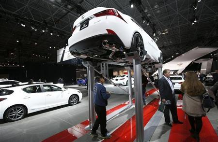 A Lexus IS 250 is seen on an elevated display at the New York International Auto Show in New York City