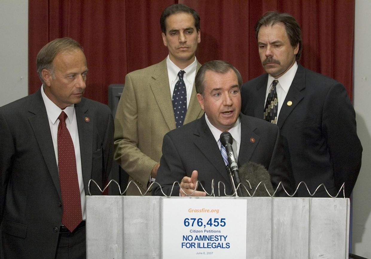 Left to right: Rep. Steve King; Steve Elliott, president of Grassfire.org; Rep. Ed Royce, R-Calif.; and Ron De Jong, communications director of Grassfire.org, in 2007, introducing a television ad that asked when a fence would be built along the border. (Photo: Saul Loeb/AFP/Getty Images)