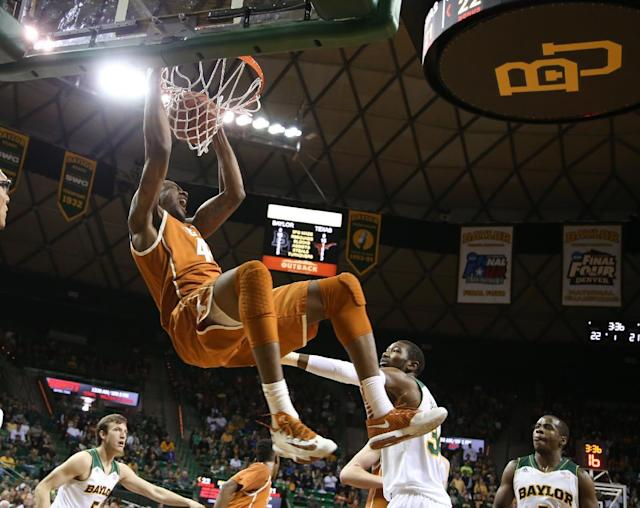 Texas center Prince Ibeh (44) scores over Baylor forward Cory Jefferson (34) in the first half of a NCAA college basketball game, Saturday, Jan. 25, 2014, in Waco, Texas. (AP Photo/Waco Tribune Herald, Rod Aydelotte)