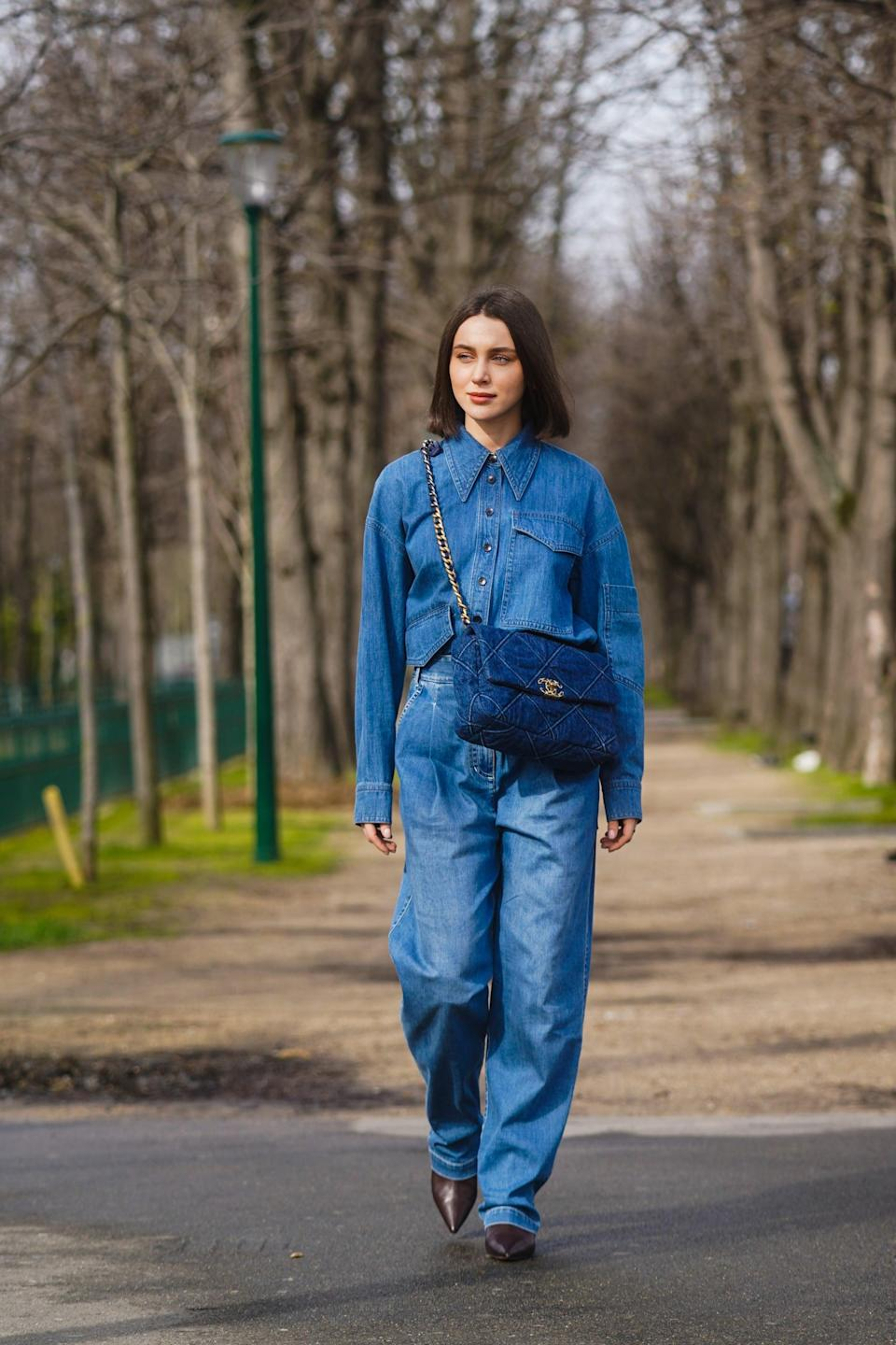 <p>For a sharper take on double denim, try tucking a button-down into high-rise baggy jeans. </p>