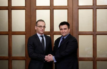 Ukrainian Foreign Minister Pavlo Klimkin (R) shakes hands with his German counterpart Heiko Maas during a meeting in Kiev, Ukraine January 18, 2019. REUTERS/Valentyn Ogirenko