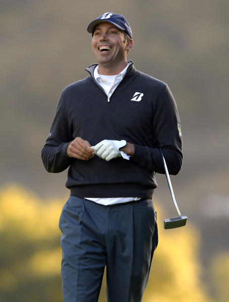 Matt Kuchar laughs after putting his ball close to the pin on the 18th green during the first round of the Northwestern Mutual World Challenge golf tournament at Sherwood Country Club, Thursday, Dec. 5, 2013, in Thousand Oaks, Calif. (AP Photo/Mark J. Terrill)