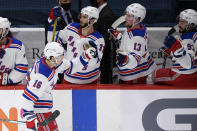 New York Rangers center Ryan Strome (16) celebrates his goal at the bench during the second period of an NHL hockey game against the Washington Capitals, Saturday, Feb. 20, 2021, in Washington. (AP Photo/Nick Wass)