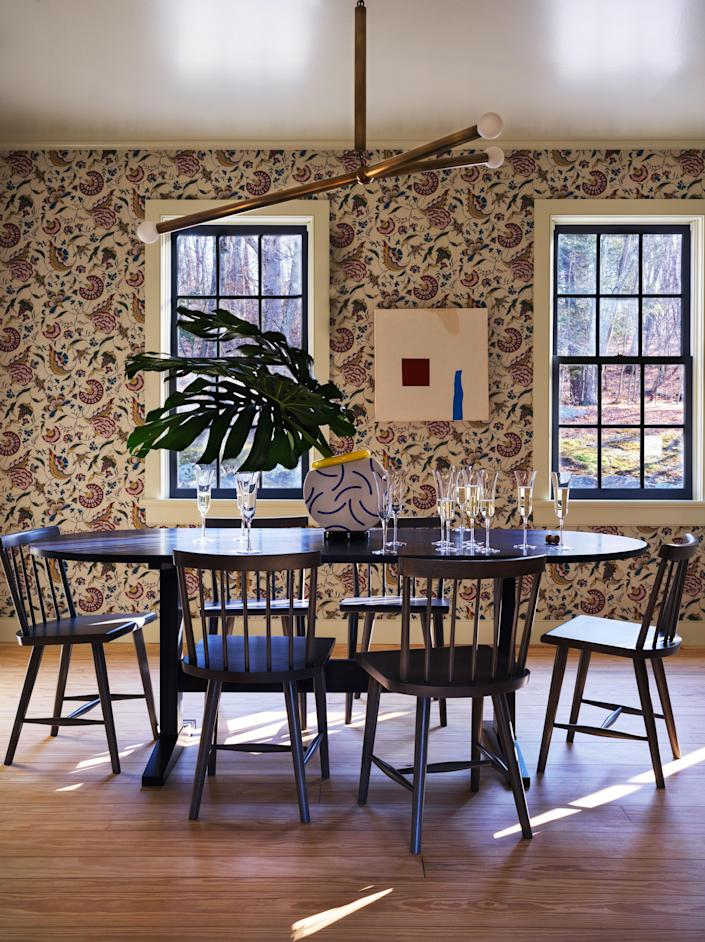 In the dining room, Antoinette Poisson wallpaper, Apparatus ceiling light, and table and chairs by O&G studio.