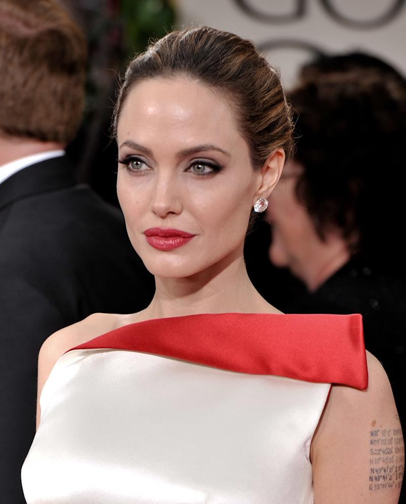 Angelina Jolie in 25-carat diamond stud earrings at the 2012 Golden Globes.