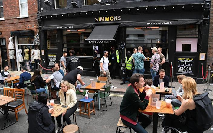 Drinkers enjoy a pint in Soho as pubs reopen on Saturday