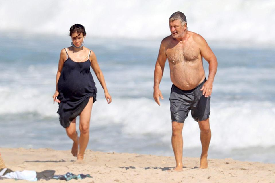<p>Alec and Hilara Baldwin make their way back to the sand during a visit to the beach in The Hamptons, New York, on Thursday.</p>