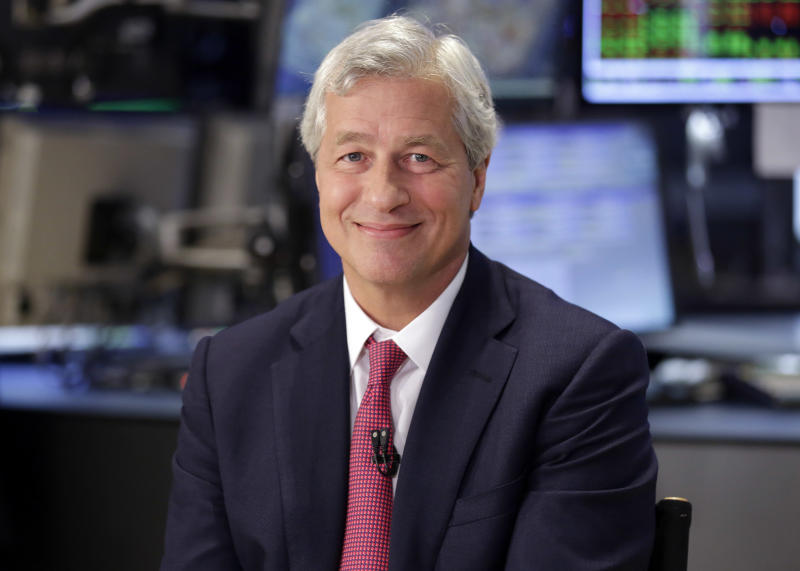 FILE - In this Friday July 12, 2013, file photo, JPMorgan Chase Chairman and CEO Jamie Dimon is interviewed on the floor of the New York Stock Exchange. JPMorgan Chase, the biggest U.S. bank by assets, reported on Friday, Oct. 11, 2013, a third-quarter loss after a big charge for legal expenses. (AP Photo/Richard Drew, File)