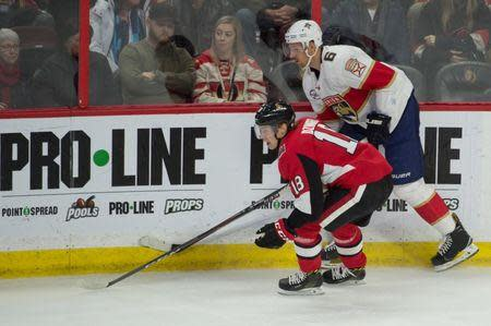 Nov 19, 2018; Ottawa, Ontario, CAN; Ottawa Senators left wing Ryan Dzingel (18) and Florida Panthers defenseman Alexander Petrovic (6) chase the puck in the third period at the Canadian Tire Centre. Mandatory Credit: Marc DesRosiers-USA TODAY Sports