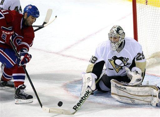 Montreal Canadiens center Scott Gomez (11) is stopped by Pittsburgh Penguins goalie Marc-Andre Fleury (29) during the second period of an NHL hockey game Tuesday, Feb. 7, 2012, in Montreal. (AP Photo/The Canadian Press, Ryan Remiorz)