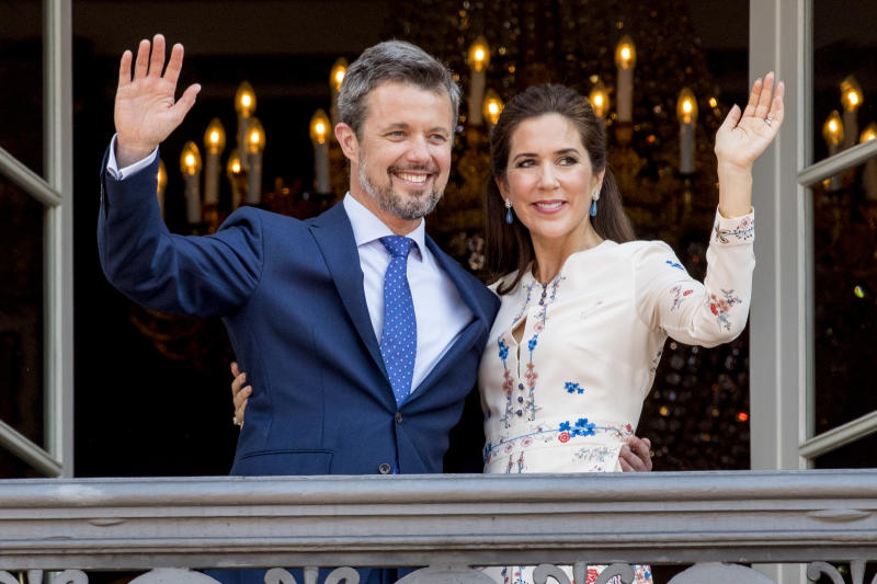 Crown Prince Frederik of Denmark and Crown Princess Mary of Denmark appear on the balcony as the Royal Life Guards carry out the changing of the guard on Amalienborg Palace square on the occasion of the 50th birthday of The Crown Prince Frederik of Denmark on May 26, 2018 in Copenhagen, Denmark.