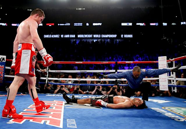 Canelo Alvarez (L) watches after knocking out Amir Khan during their WBC middleweight title fight on May 7, 2016, in Las Vegas. (AP Photo)