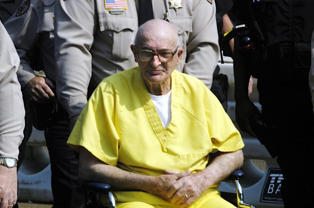 <p>Edgar Ray Killen is escorted int o the Neshoba County Courthouse before sentencing June 23, 2005 in Philadelphia, Mississippi. Killen , 80, was convicted on June 21, 2005 in the 1964 murders of civil rights activists Andrew Goodman, James Chaney and Michael Schwerner. He received three consecutive 20 year sentences for the murders. (Photo: Marianne Todd/Getty Images) </p>